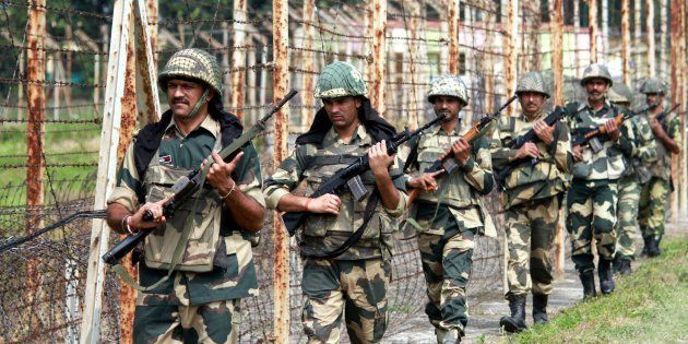 Border Security Force soldiers keep vigil as they patrolling at International border (Octroi Post) about...