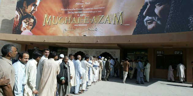 People line up to buy tickets for the first screening in Pakistan of Indian classic movie Mughal-e-Azam at Gulistan at a cinema in Lahore April 23, 2006. The forbidden love of Pakistanis for Indian movies was allowed into the open on Sunday with the public screening of a 1960 classic beloved on both sides of the border.  REUTERS/Mohsin Raza