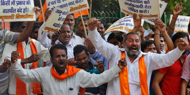 Supporters of Shiv Sena shout slogans during a protest against militant attack in