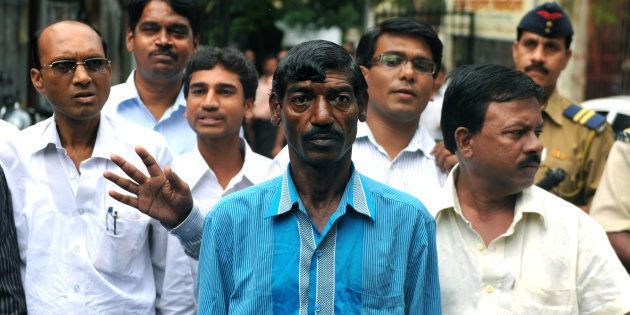 Bhaiyalal Bhotmange (centre) arrives for a press conference in Mumbai on 28 July 2010. SAJJAD HUSSAIN/AFP/Getty