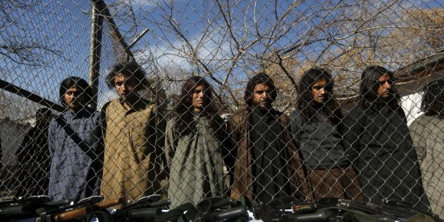 Pakistani Taliban fighters, who were arrested by Afghan border police, stand during a presentation of...