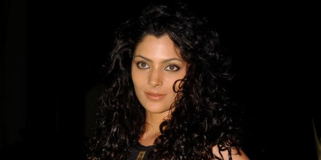 Indian model Saiyami Kher attends the 'Society Young Achiever Awards' 2013 in Mumbai on October 19, 2013....