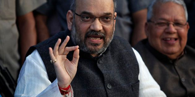 Amit Shah, a leader of India's main opposition Bharatiya Janata Party (BJP), speaks during a news conference...