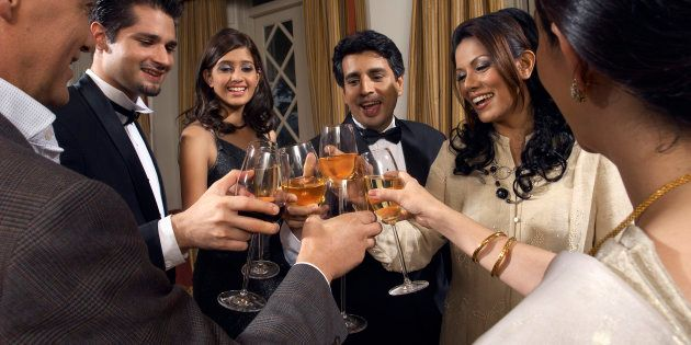 Dinner Guests Toasting Glasses