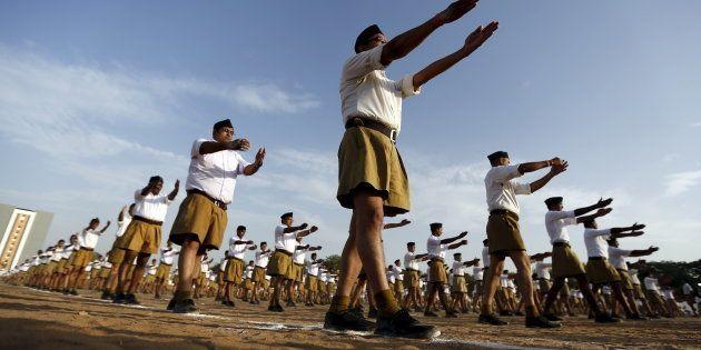 Volunteers of the Hindu nationalist organisation Rashtriya Swayamsevak Sangh (RSS) exercise as they take...