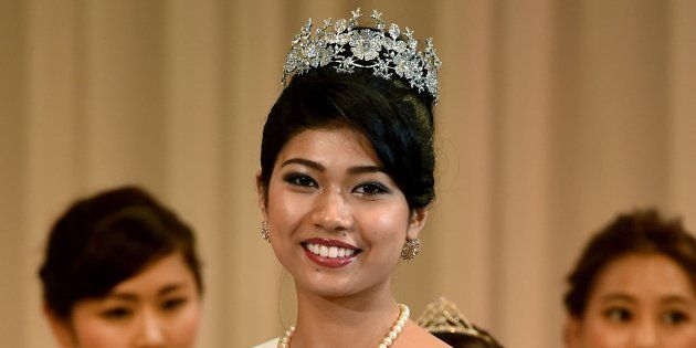 Priyanka Yoshikawa smiles as she holds the trophy after winning the Miss Japan title during the Miss...