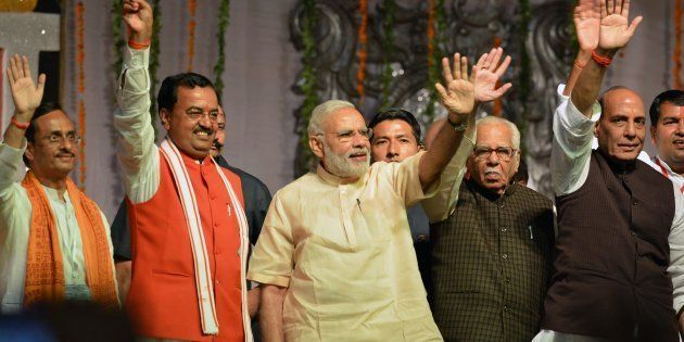Indian Prime Minister Narendra Modi (C) takes part in Dussehra celebrations, next to Uttar Pradesh Governor...