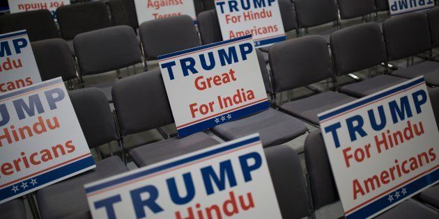 Signs expressing Hindu support for Republican presidential candidate Donald Trump are seen during a Hindu...