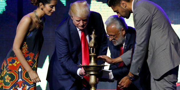 Republican Hindu Coalition Chairman Shalli Kumar (2nd R) helps Republican presidential nominee Donald...