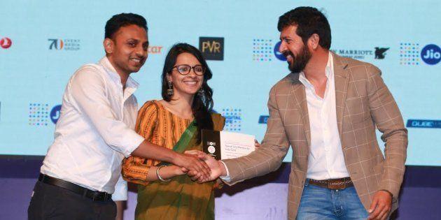 Filmmaker Kabir Khan hands out the Young Critics Choice award to Amit Madhesiya and Shirley Abraham for 'The Cinema Travellers.'