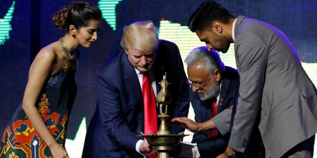 Republican Hindu Coalition Chairman Shalli Kumar (2nd R) helps Republican presidential nominee Donald...