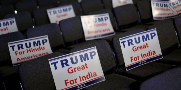 Signs are ready for attendees to hold during Republican presidential nominee Donald Trump's remarks at...