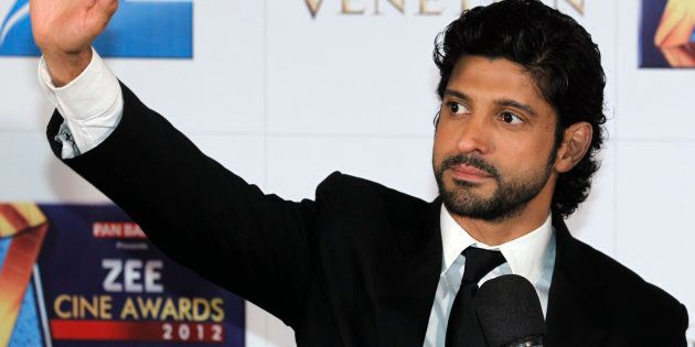 India's director-actor Farhan Akhtar waves on the red carpet of the Zee Cine Awards 2012 in Macau Saturday, Jan. 21, 2012.  (AP Photo/Kin Cheung)
