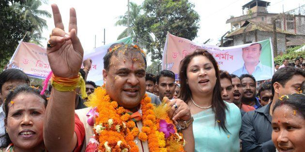 Indian candidate Himanta Biswa Sarma (2nd L) of the BJP is accompanied by supporters on the way to file...