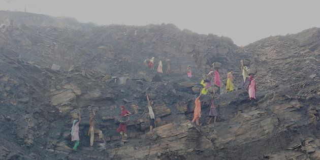 Coal scavengers work very early in the morning before the mine officials come inside the mines in Jharia.