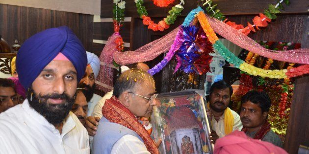 BJP leader Arun Jaitley and Punjab Cabinet Minister Bikram Singh Majithia offer prayer at Chavinda Devi...