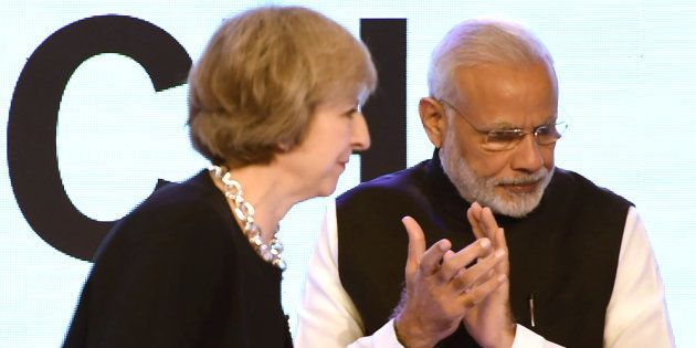 File photo of Britain's Prime Minister Theresa May (L) and Indian Prime Minister Narendra