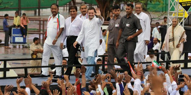 Rahul Gandhi, vice-president of India's main opposition Congress party, waves to his party workers as...