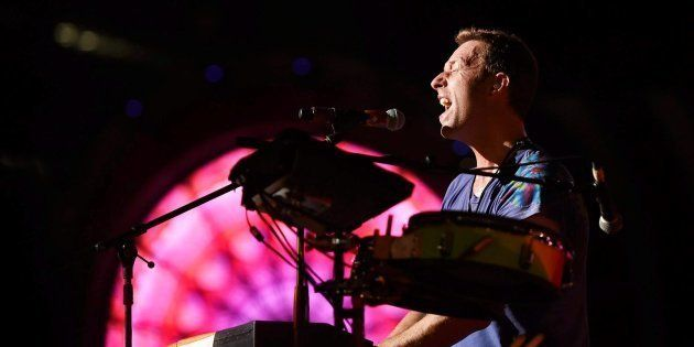 Chris Martin of British Band Coldplay performs during the Global Citizen concert in Mumbai on