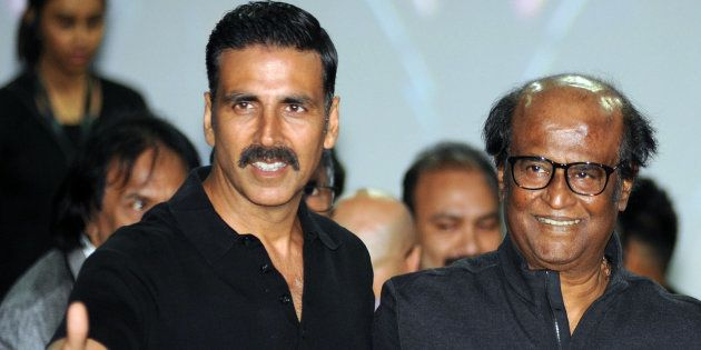 Indian Bollywood actors Akshay Kumar (L) and Rajinikanth pose for a photograph during a promotional event...