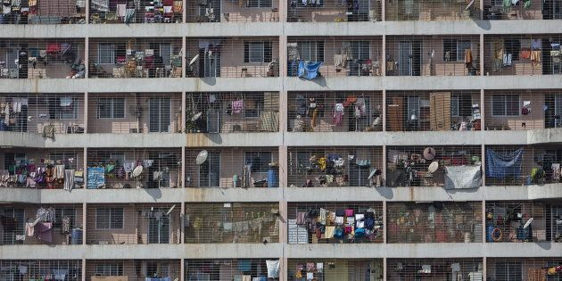 Windows of various apartments of a high-rise residential building are seen in the western suburb of