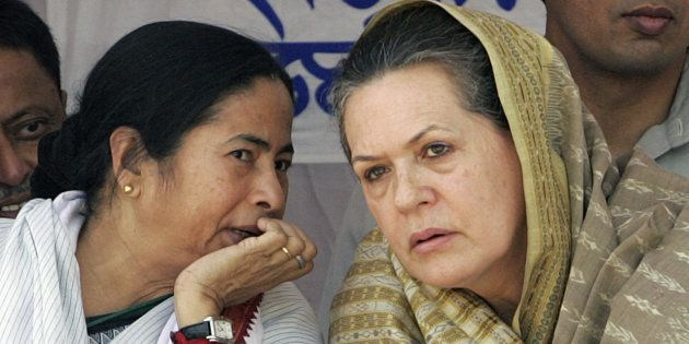 File photo of India's Congress party president Sonia Gandhi (R) and Mamata Banerjee from the Trinamool...