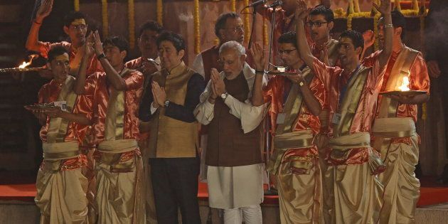 Japan's Prime Minister Shinzo Abe (front, 3rd L) and his Indian counterpart Narendra Modi perform a religious...