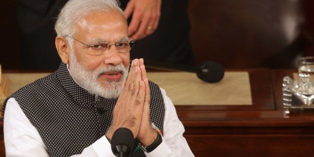 WASHINGTON, DC - JUNE 08: Indian Prime Minister Narendra Modi salutes while addressing a joint meeting...