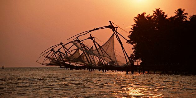 Chinese fishing nets line the mouth of the harbour at Fort Cochin, an old Portuguese town in
