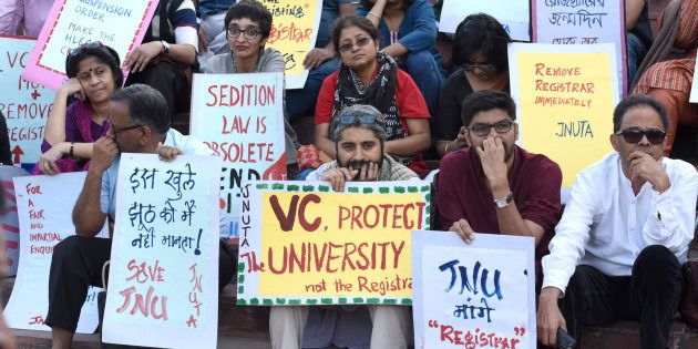 JNU teachers protest against the arrest of JNUSU students at JNU campus, on March 9, 2016 in New Delhi,...