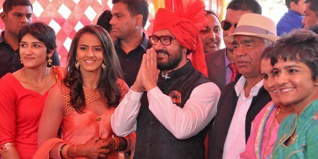 [File photo] Aamir Khan with Mahavir Singh Phogat and his family during the wedding function of Olympian...