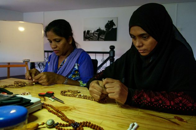 Skilled but disenfranchised women at Khusi Hona's Lotus Centre in Goa making a piece of