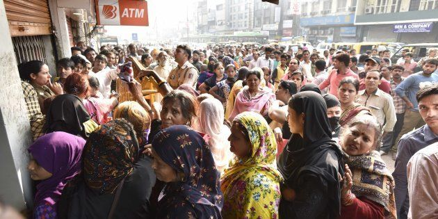 People in queue outside a bank to deposit and exchange 500 and 1000 currency notes at