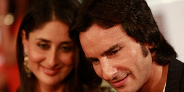 Bollywood actor Saif Ali Khan (R) arrives with actress Kareena Kapoor on the green carpet for the International...