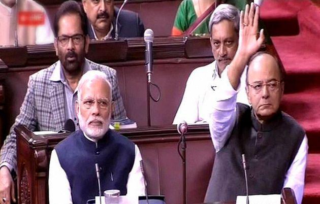 New Delhi: Prime Minister Narendra Modi and Finance Minister Arun Jaitley in the Rajya Sabha in New Delhi...