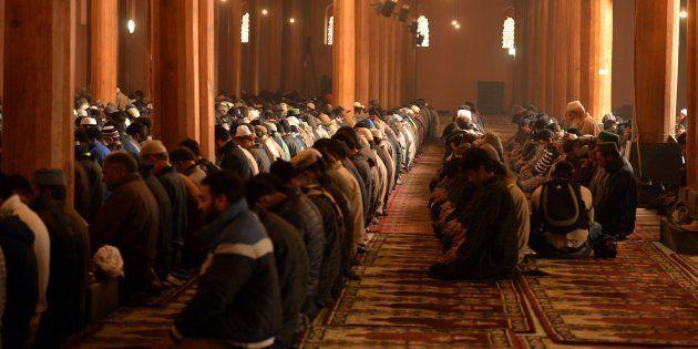 Kashmiri Muslims pray during the Friday prayer in Jamia Masjid in downtown Srinagar on November 25, 2016....