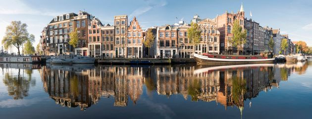 Amstel river panorama in Amsterdam. Shot on a clear autumn morning with no