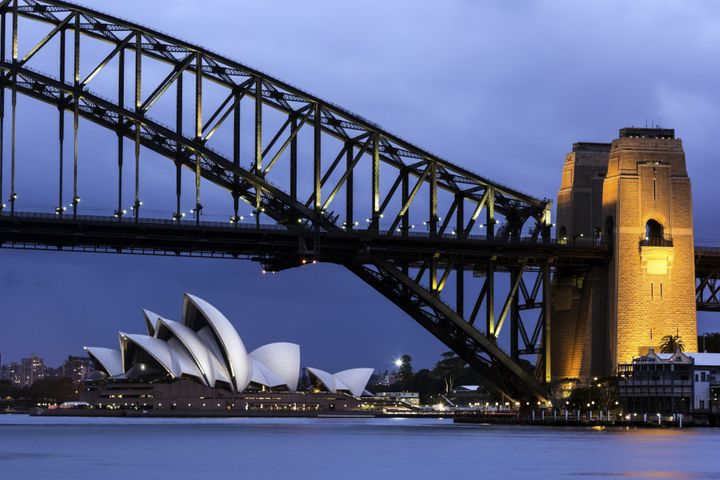 Australia, New South Wales, Sydney, Cityscape view of bridge and Opera House