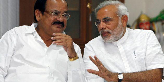 Venkaiah Naidu (L) and Narendra Modi at a meeting in New Delhi May 18, 2009. REUTERS/Adnan