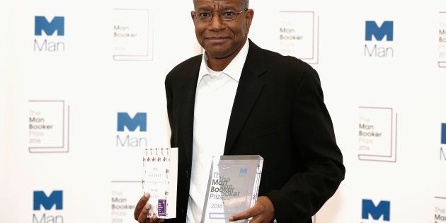 Winner of the 2016 Man Booker Prize Paul Beatty poses with his novel 'The Sellout' at the 2016 Man Booker...