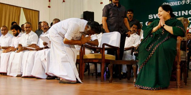 Former chief minister O. Panneerselvam bows in front of AIADMK leader Jayaram Jayalalitha after she took...