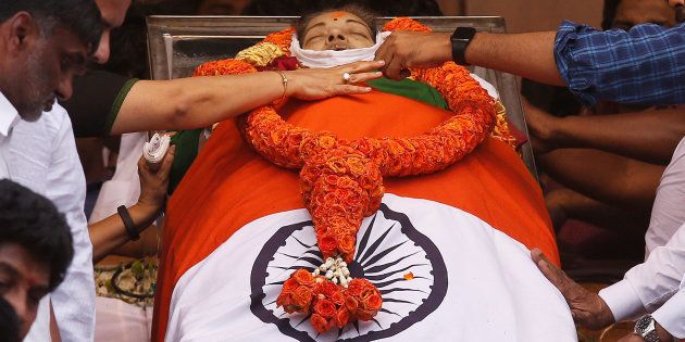 People pay homage to the body of Tamil Nadu Chief Minister Jayalalithaa Jayaraman, who died on Monday,...