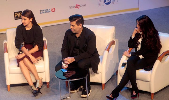 Anushka Sharma, Karan Johar, center, and actress Aishwarya Rai participate in a talk show during MAMI 18th Mumbai Film Festival in Mumbai.