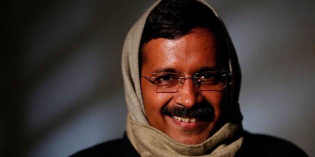 Delhi's Chief Minister Arvind Kejriwal, chief of the Aam Aadmi (Common Man) Party (AAP), smiles during...
