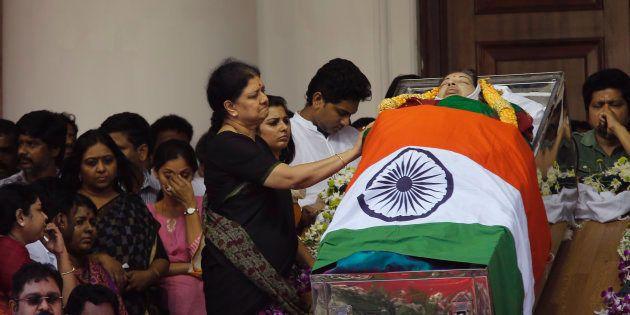 Sasikala Natarajan next to Chief Minister J Jayalalithaa's body in Chennai, on 6 December 2016. (AP Photo/Aijaz