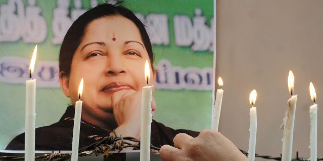 Indian supporters of Indian politician and actress Jayalalithaa Jayaraman, light candles as they pay...