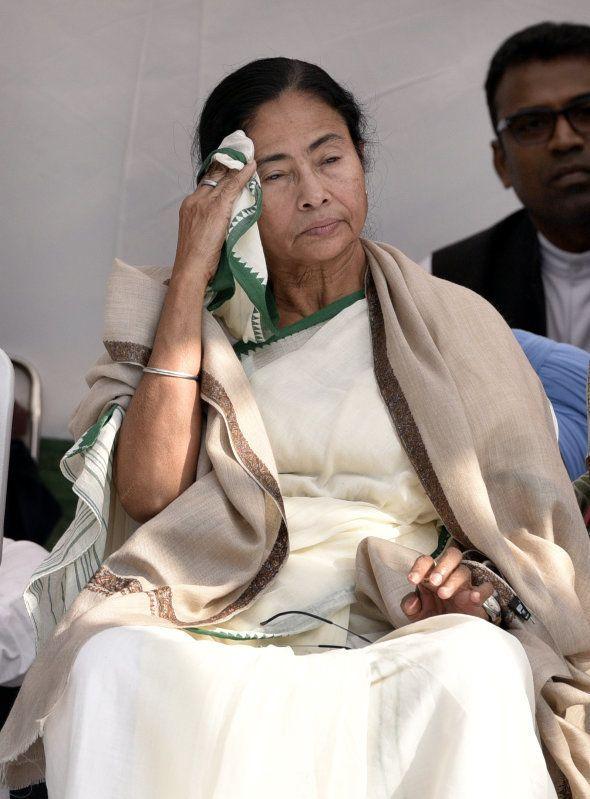TMC leader Mamata Banerjee wipes her face during the dharna against demonetization, at Jantar Mantar...