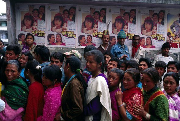 People in a queue outside a cinema hall for buying a ticket for an Indian movie. Sikkim,