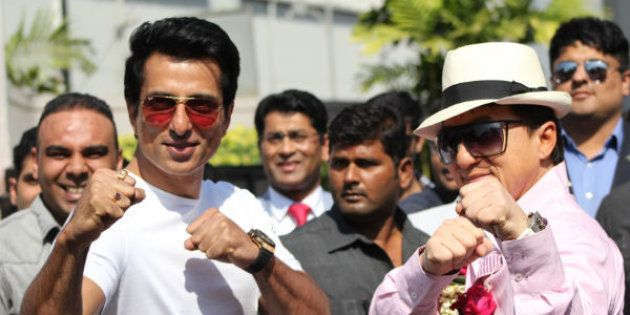 Jackie Chan and Sonu Sood strike fighting poses outside Mumbai airport.