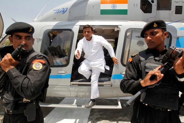 Akhilesh Yadav, chief minister of the northern Indian state of Uttar Pradesh, disembarks from a helicopter...